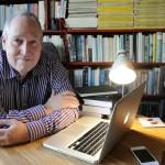 John Ironmonger at desk